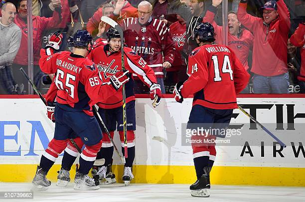 Evgeny Kuznetsov of the Washington Capitals celebrates his third period goal with his teammates Andre Burakovsky and Justin Williams during their...