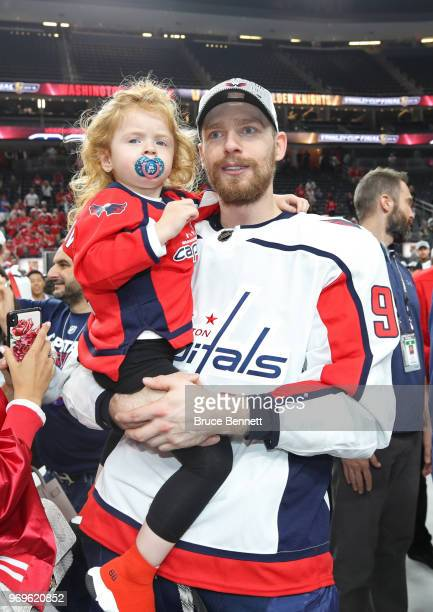 Evgeny Kuznetsov of the Washington Capitals celebrates with his daughter Ecenia Kuznetsov after his team's win over the Vegas Golden Knights in Game...