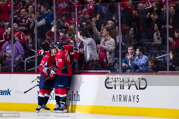 Evgeny Kuznetsov of the Washington Capitals celebrates with his teammates TJ Oshie and John Carlson after scoring a second period goal against the...