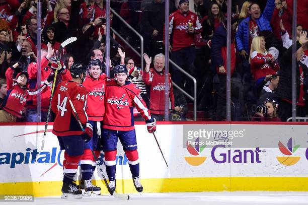 Evgeny Kuznetsov of the Washington Capitals celebrates with his teammates Tom Wilson and Brooks Orpik after scoring a first period goal against the...