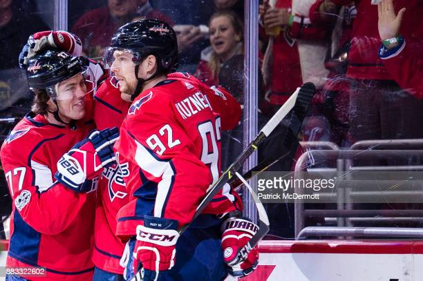 Evgeny Kuznetsov of the Washington Capitals celebrates with TJ Oshie after scoring a first period goal against the Los Angeles Kings at Capital One...