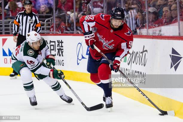 Evgeny Kuznetsov of the Washington Capitals controls the puck against Jared Spurgeon of the Minnesota Wild in the first period at Capital One Arena...