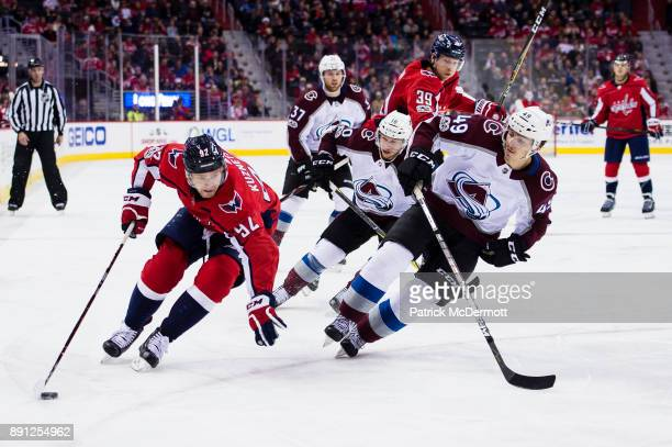 Evgeny Kuznetsov of the Washington Capitals controls the puck against Samuel Girard of the Colorado Avalanche in the third period at Capital One...