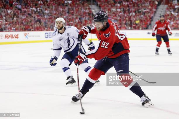 Evgeny Kuznetsov of the Washington Capitals controls the puck against Ryan Callahan of the Tampa Bay Lightning in the second period of Game Six of...
