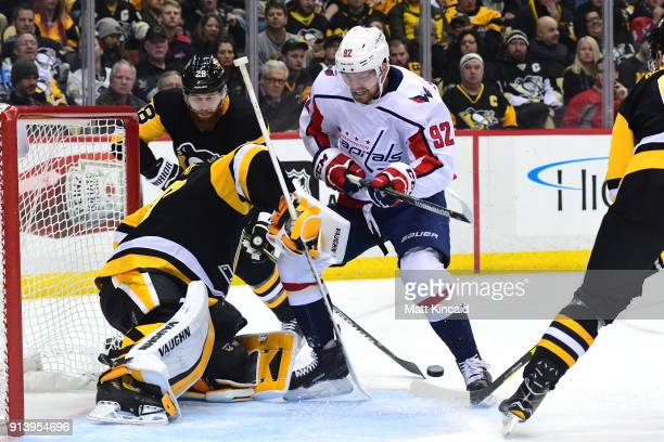 Evgeny Kuznetsov of the Washington Capitals drives with the puck against Matt Murray of the Pittsburgh Penguins at PPG PAINTS Arena on February 2...