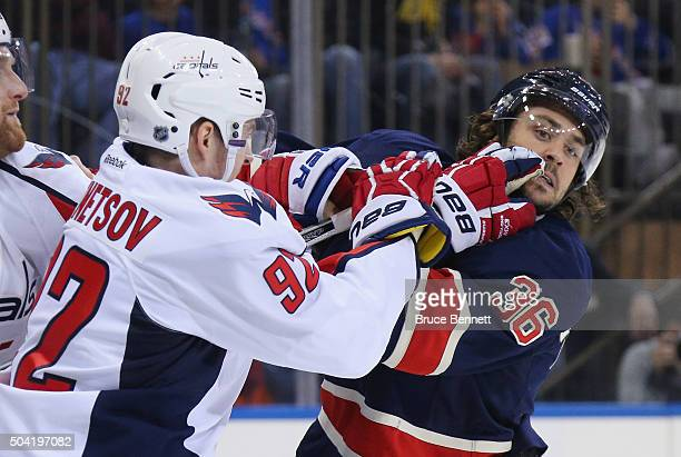 Evgeny Kuznetsov of the Washington Capitals gets the glove up on Mats Zuccarello of the New York Rangers during the second period at Madison Square...