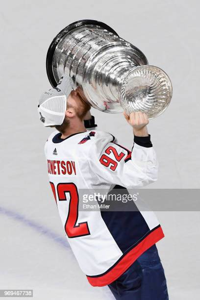 Evgeny Kuznetsov of the Washington Capitals hoists the Stanley Cup after his team's 43 win over the Vegas Golden Knights in Game Five of the 2018 NHL...