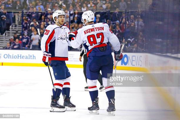 Evgeny Kuznetsov of the Washington Capitals is congratulated by Lars Eller after scoring a goal during the third period in Game Four of the Eastern...