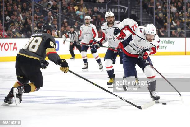 Evgeny Kuznetsov of the Washington Capitals is defended by Nate Schmidt of the Vegas Golden Knights during the first period in Game One of the 2018...