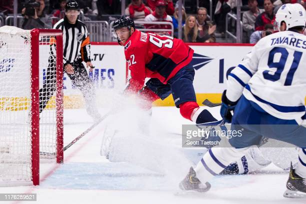 Evgeny Kuznetsov of the Washington Capitals scores a goal against Michael Hutchinson of the Toronto Maple Leafs during the second period at Capital...