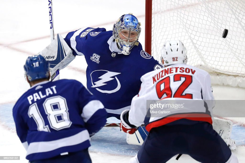 Evgeny Kuznetsov #92 of the Washington Capitals scores a goal on Andrei Vasilevskiy #88 of the Tampa Bay Lightning during the second period in Game Five of the Eastern Conference Finals during the 2018 NHL Stanley Cup Playoffs at Amalie Arena on May 19, 2018 in Tampa, Florida.