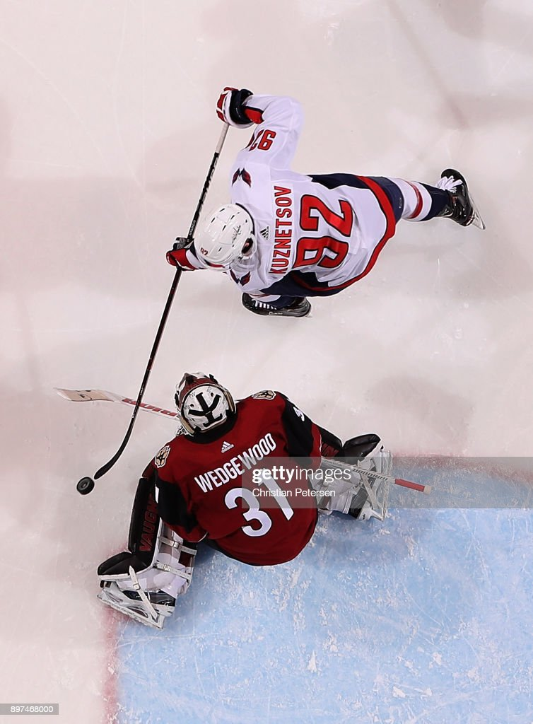 Evgeny Kuznetsov #92 of the Washington Capitals scores a goal past goaltender Scott Wedgewood #31 of the Arizona Coyotes during the third period of the NHL game at Gila River Arena on December 22, 2017 in Glendale, Arizona. The Coyotes defeated the Capitals 3-2 in overtime.
