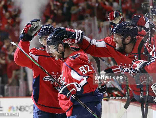 Evgeny Kuznetsov of the Washington Capitals scores at 13:22 of the second period as Alex Ovechkin of the Washington Capitals congratulates him during...