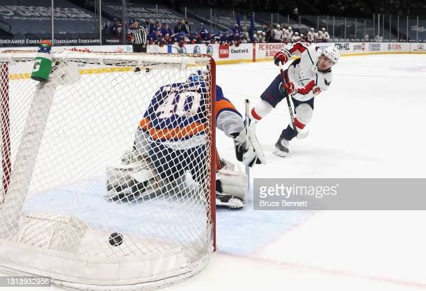 Evgeny Kuznetsov of the Washington Capitals scores the game winning goal in the shoot-out against Semyon Varlamov of the New York Islanders at the...
