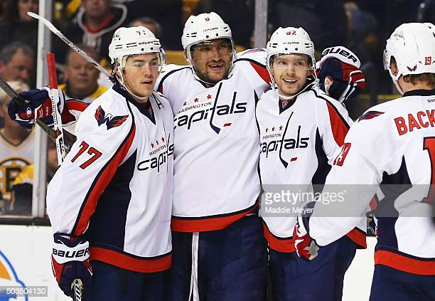 Evgeny Kuznetsov of the Washington Capitals second from right celebrates with TJ Oshie Alex Ovechkin and Nicklas Backstrom after scoring a goal...
