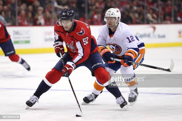 Evgeny Kuznetsov of the Washington Capitals skates past Josh Bailey of the New York Islanders during the second period at Capital One Arena on March...
