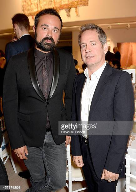 Evgeny Lebedev and Tom Hollander attend the launch party for Phillips European Headquarters at 30 Berkeley Square on October 13 2014 in London England