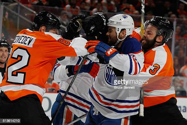 Evgeny Medvedev and Radko Gudas of the Philadelphia Flyers go up against Zack Kassian of the Edmonton Oilers during the third period at the Wells...