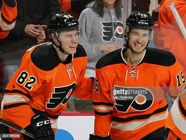 Evgeny Medvedev of the Philadelphia Flyers celebrates his second period goal against the New York Islanders with teammate Michael Del Zotto on...