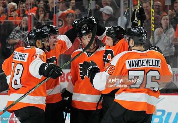 Evgeny Medvedev of the Philadelphia Flyers celebrates his third period gamewinning goal against the St Louis Blues with teammates PierreEdouard...