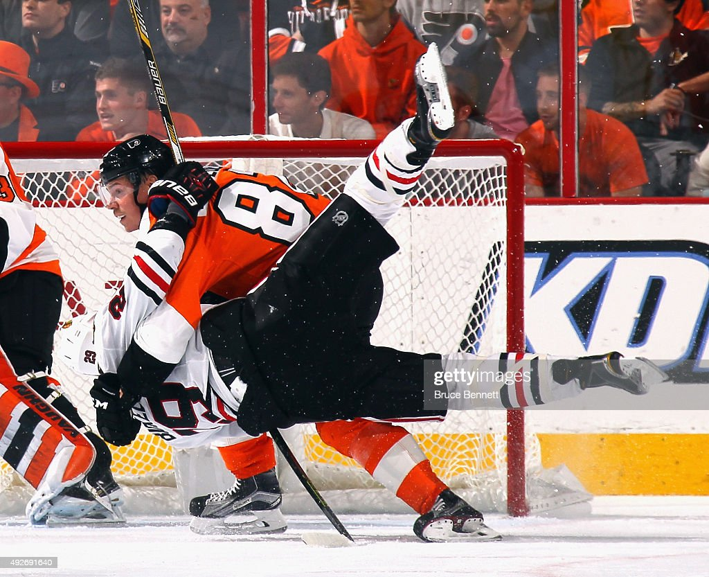 Evgeny Medvedev #82 of the Philadelphia Flyers wrestles with Bryan Bickell #29 of the Chicago Blackhawks during the second period at the Wells Fargo Center on October 14, 2015 in Philadelphia, Pennsylvania.