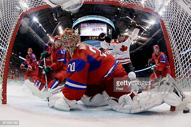 Evgeny Nabokov of Russia gives up a goal against Brenden Morrow of Canada in the first period during the ice hockey men's quarter final game between...