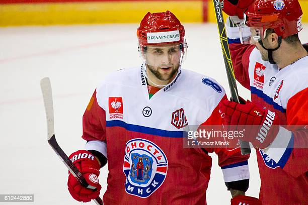 Evgeny Nogachyov of Yunost Minsk and Sabahusin Kovacevic after the 3rd period of Champions Hockey League Round of 32 match between Yunost Minsk and...