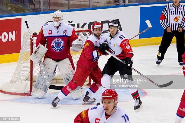 Evgeny Nogachyov of Yunost Minsk pushes back from the goal Mats Rosseli Olsen of Frolunda Gotenburg during the 3rd period of Champions Hockey League...
