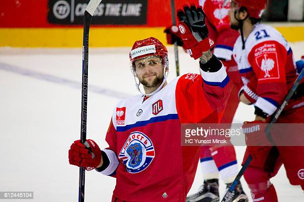 Evgeny Nogachyov of Yunost Minsk sends greetings to fans after the 3rd period of Champions Hockey League Round of 32 match between Yunost Minsk and...
