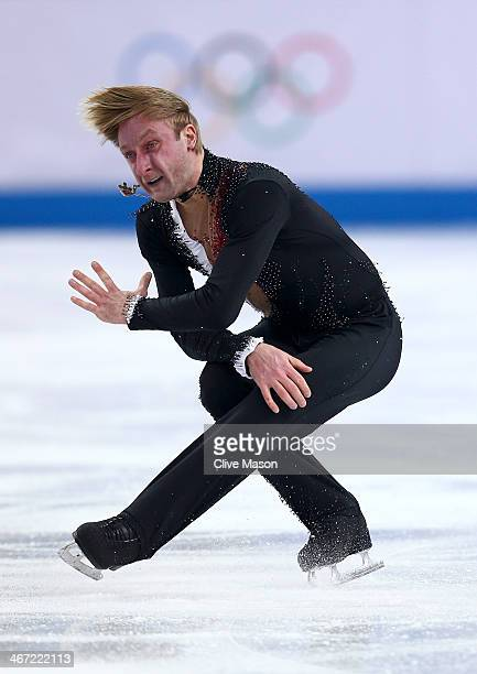 Evgeny Plyushchenko of Russia competes in the Figure Skating Men's Short Program during the Sochi 2014 Winter Olympics at Iceberg Skating Palace on...