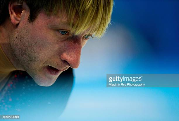 Evgeny Plyushchenko of Russia is seen at at a warm up during the Men's Figure Skating Short Program on day 6 of the Sochi 2014 Winter Olympics at the...