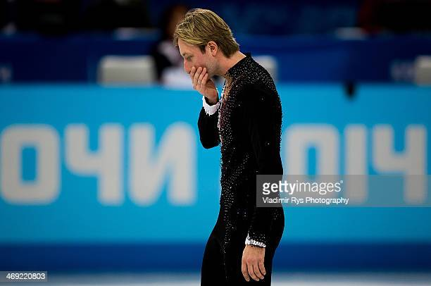 Evgeny Plyushchenko of Russia reacts after his injury at a warm up during the Men's Figure Skating Short Program on day 6 of the Sochi 2014 Winter...