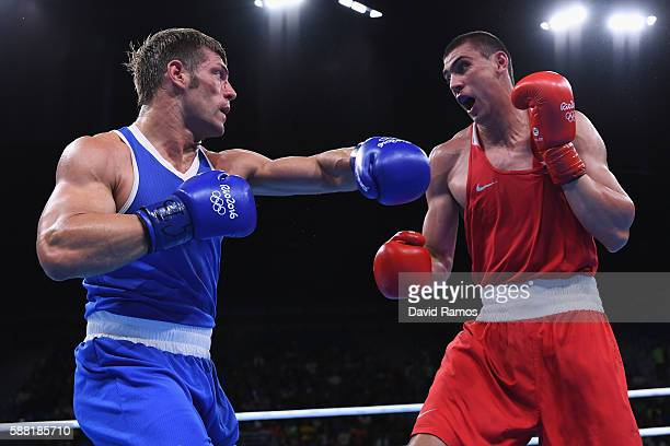 Evgeny Tishchenko of Russia and Clemente Russo of Italy compete in the Men's Heavy quarterfinals round fight on Day 5 of the Rio 2016 Olympic Games...
