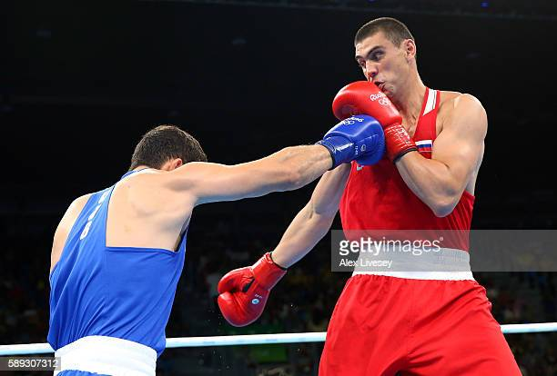 Evgeny Tishchenko of Russia and Rustam Tulaganov of Uzbekistan during the Men's Heavyweight preliminaries bout on Day 8 of the 2016 Rio Olympics at...