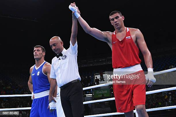 Evgeny Tishchenko of Russia celebrates defeating Clemente Russo of Italy in the Men's Heavy quarterfinals round fight on Day 5 of the Rio 2016...