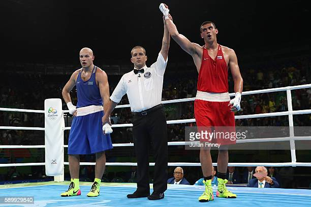 Evgeny Tishchenko of Russia celebrates winning the gold medal after the mens heavyweight 91kg next to Vassiliy Levit of Kazakhstan during the Boxing...
