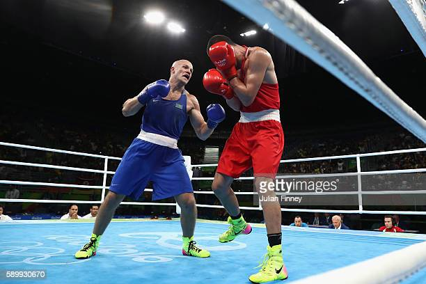 Evgeny Tishchenko of Russia fights Vassiliy Levit of Kazakhstan for the gold medal in the mens heavyweight 91kg during the Boxing at Riocentro on...