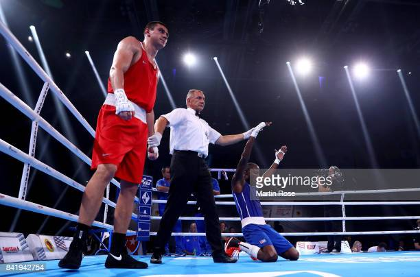 Evgeny Tishchenko of Russia looks dejected after lsing against Erislandy Savon of Cuba in the Men's heavy during the final of the AIBA World Boxing...