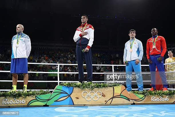 Evgeny Tishchenko of Russia with the gold Vassiliy Levit of Kazakhstan with silver Rustam Tulaganov of Uzbekistan with bronze and Erislandy Savon of...