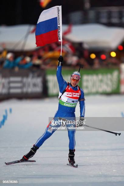 Evgeny Ustygov of Russia celebrates winning the Men's 4 x 75km Relay in the eon Ruhrgas IBU Biathlon World Cup on January 17 2010 in Ruhpolding...