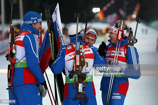 Evgeny Ustygov of Russia celebrates winning with his team mates Anton Shipulin Maxim Tchoudov and Ivan Tcherezov after the Men's 4 x 75km Relay in...