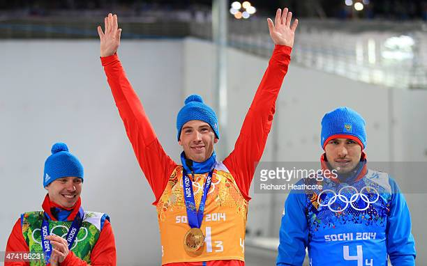 Evgeny Ustyugov Dmitry Malyshko and Anton Shipulin of Russia receive the gold medals won during the Men's 4 x 75 km Relay during day 15 of the Sochi...