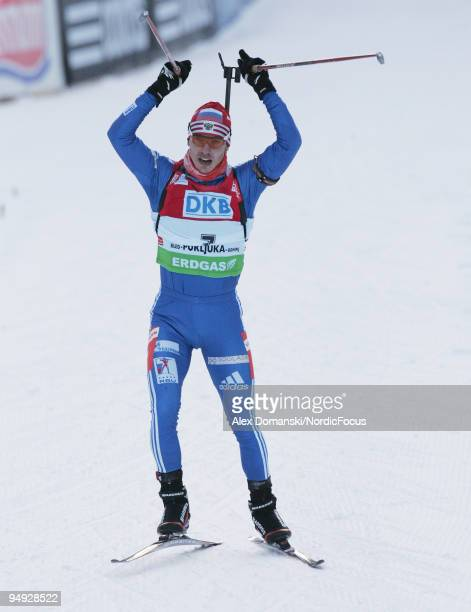 Evgeny Ustyugov of Russia celebrates on the finish line after winning the Men's 10km Pursuit in the eon Ruhrgas IBU Biathlon World Cup on December 20...