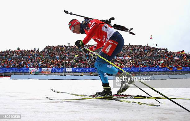 Evgeny Ustyugov of Russia competes in the men's 125km pursuit event during the IBU Biathlon World Cup on January 4 2014 in Oberhof Germany