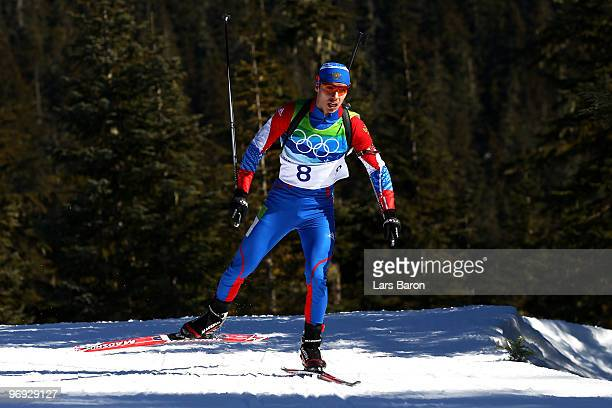 Evgeny Ustyugov of Russia competes in the men's biathlon 15 km mass start on day 10 of the 2010 Vancouver Winter Olympics at Whistler Olympic Park...