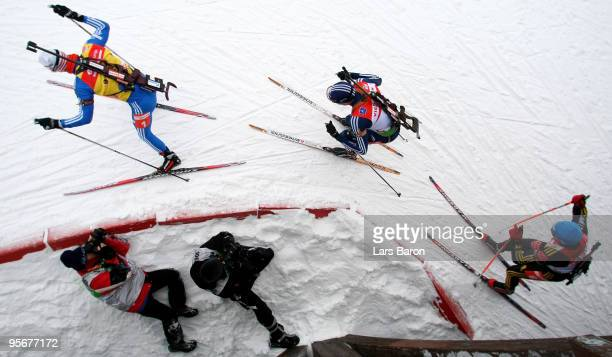 Evgeny Ustyugov of Russia competes infront of Tim Burke of USA and Michael Greis of Germany during the Men's 15 km mass start in the eon Ruhrgas IBU...