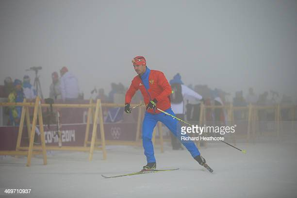 Evgeny Ustyugov of Russia passes the shooting range after the competition was postponed due to fog before the Men's 15 km Mass Start during day nine...