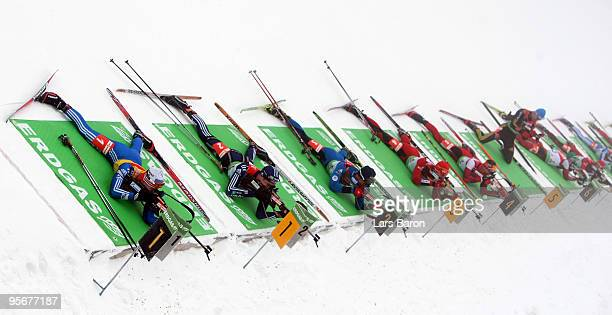 Evgeny Ustyugov of Russia Tim Burke of USA Simon Fourcade of France Emil Hegle Svendsen of Norway Christoph Sumann of Austria and Michael Greis of...