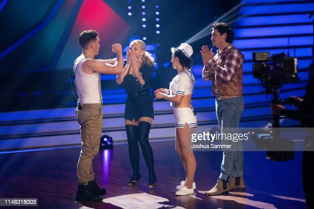 Evgeny Vinokurov Evelyn Burdecki Sabrina Mockenhaupt and Erich Klann react after the announcement onstage during the 7th show of the 12th season of...
