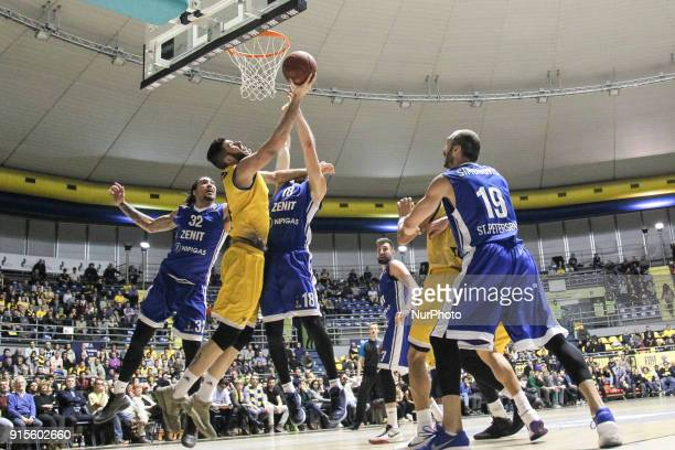 Evgeny Voronov and Valerio Mazzola compete for the ball during the EuroCup basketball match between Fiat Torino Auxilium and Zenit St Petersburg at...
